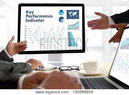 Kpi Acronym (key Performance Indicator) Business Team Hands At Work With Financial Reports And A Lap