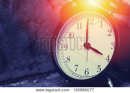4 O'clock Vintage Clock At Dark Color Tone With Sun Light Memory Time Concept.