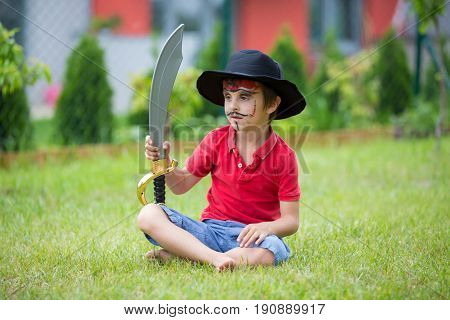 Cute School Boy, Playing Games, Painted As Pirate, Holding Sword