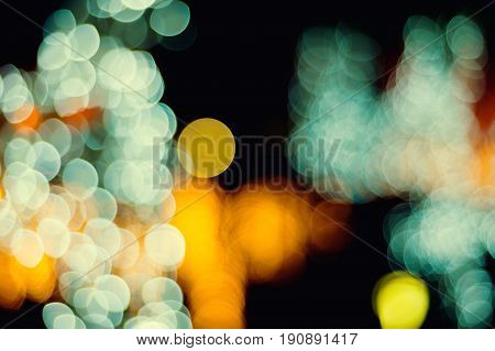 Bokeh christmas light night city abstract colorful blurred on black background vintage style