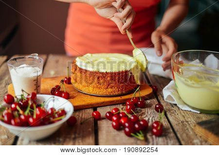 Ingredients for baking cake stuffed with fresh cherry pie. Female preparing cherry pie. Rustic dark style. See series recipe step on step. Womans hands. Recipe for homemade pie on short pastry