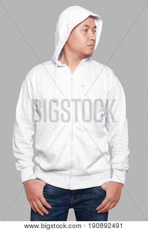 Blank sweatshirt mock up front view isolated on grey. Asian male model wear plain white hoodie mockup. Hoody design presentation. Jumper for print. Blank clothes sweat shirt sweater