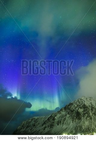 Amazing Picturesque Unique Nothern Lights Aurora Borealis Over Lofoten Islands in Nothern Part of Norway. Over the Polar Circle. Vertical Image Composition