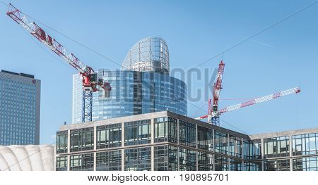Crane Who Are Working On The Construction Of New Buildings In The Defense Business District