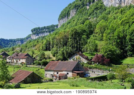 The village of Baume-les-Messieurs lies within the most extensive of the steephead valleys of the Jura escarpment the