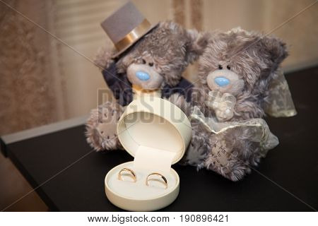 Amazing romantic gift for girlfrined for Valentine's Day: sad teddy bear in a nice dress, a casket with a gold ring with a small diamond and a beautiful felt red heart, wedding