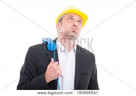 Architect Looking Bored With Telephone Receiver On Shoulder