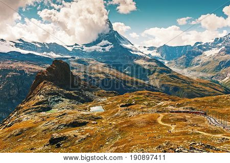Beautiful mountains landscape Matterhorn covered with clouds
