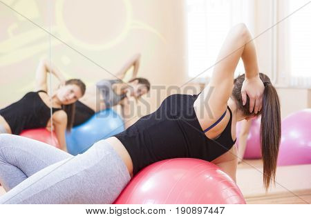 Two Female Caucasian Athletes Having a Work Out Training in Gym Indoors.Horizontal Image