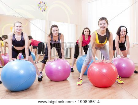 Sport and Fitness Concepts and Ideas. Group of Five Caucasian Female Athletes Having Exercises With Fitballs in Gym Together.Horizontal Image