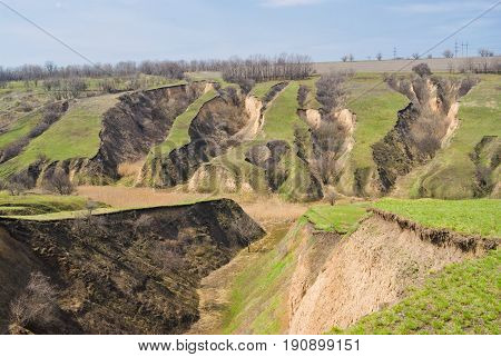 Landscape with soil erosion at spring season in Ukraine .
