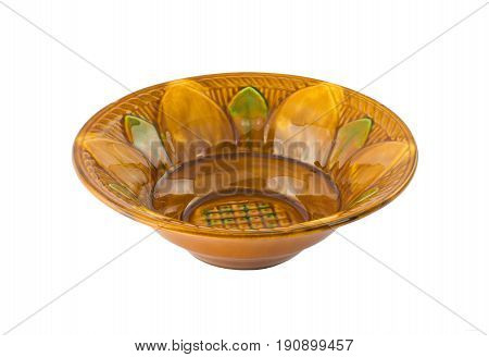 Clay glazed soup plate with ornament on a white background.