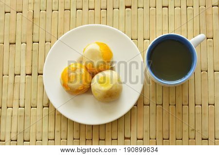 Chinese stuffed mashed bean and salty egg yolk with tea cup