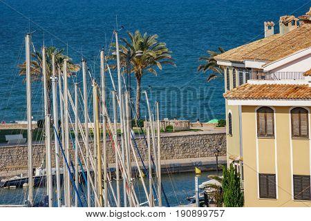 Top of sailing ship masts, houses and sea