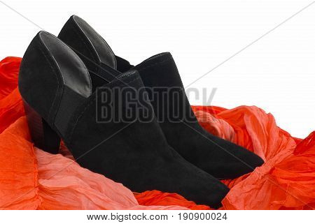 Black woman's shoes on a red and white background