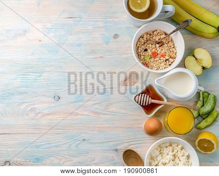 Breakfast with vitamins, oatmeal and nuts, honey and cottage cheese, additional copyspace left on side