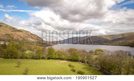 Ullswater, English Lake District. Aerial drone image of the landscape surrounding Ullswater in the English Lake District on a bright spring day.