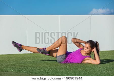 Exercise fitness woman training abs sit up at home. Asian girl doing bicycle crunch workout to train body core. Bodyweight floor exercises. Healthy lifestyle.