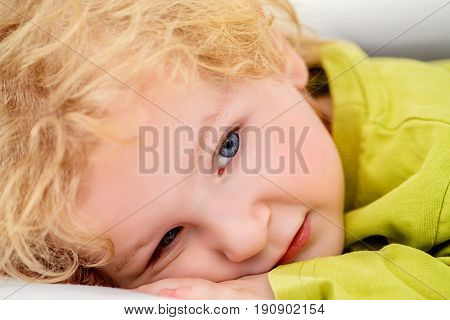Close-up portrait of a cute 3 year old boy at home. Healthcare. Happy childhood.