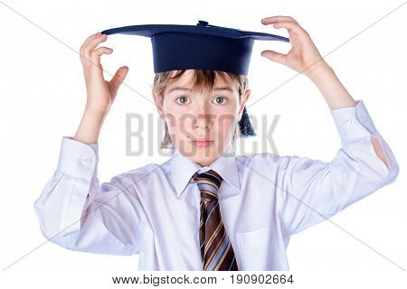 Portrait of a smart serious student boy in academic hat. Educational concept. Isolated over white.