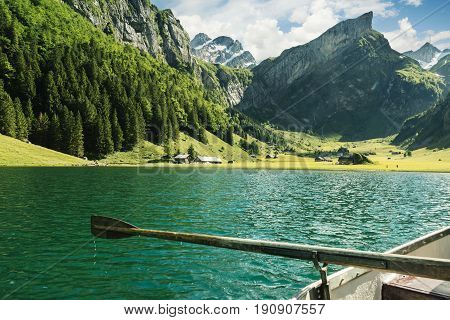 wooden rudder in front beautiful Seealpsee lake and Alpstein mountain in Appenzell Switzerland