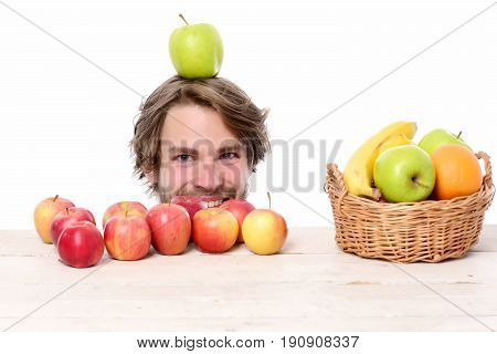 Man With Moustache Smiles And Holds Green Apple On Head
