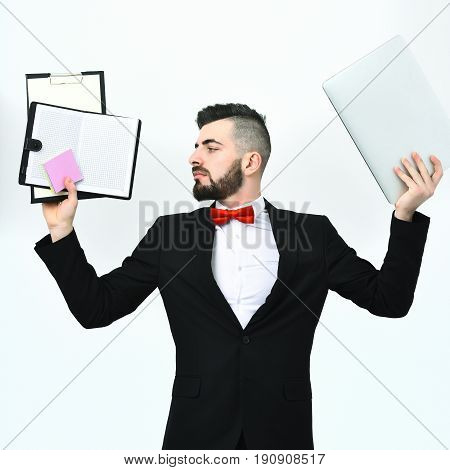 Project Manager Having Busy Look Holds Clip Folders With Paper