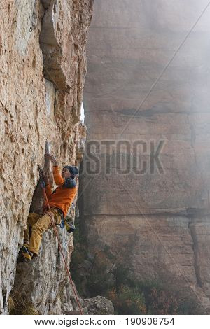 Extreme Sport Climbing. Rock Climber Struggle For Success. Outdoor Lifestyle. A Person Trying Hard T