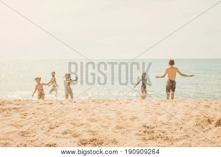 Kids playing at the beach, blurred image