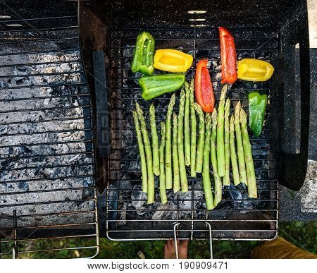 Asparagus And Bell Peppers On A Barbecue Bbq Charcoal Grill.