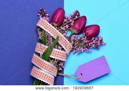 Tulips And Lilac Gathered In Bouquet With Ribbon And Label