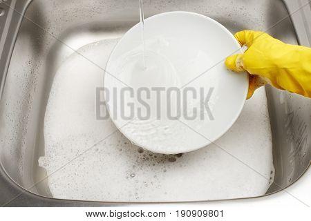 Hand In Glove Washing Plate Under Running Tap Water