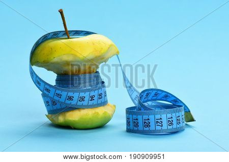 Green Apple Wrapped Tightly With Soft Measuring Tape