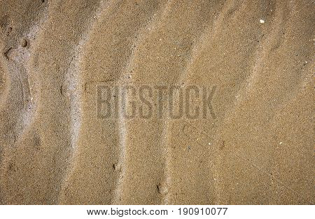 Natural Wave Pattern In Sand On A Beach Texture.