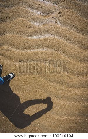 Shadow Of A Photographer Taking Picture Of Sand Waves Pattern.