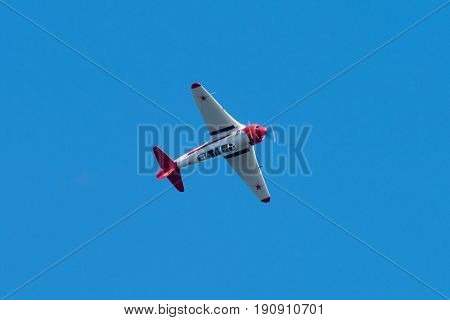 HELSINKI, FINLAND - JUNE 9, 2015: Yakovlev Yak-11 Soviet training aircraft flying upside down at the Kaivopuisto Air Show. This airplane was used by the Soviet Union and its Warsaw Pact allies June 9, 2017 in Helsinki, Finland.