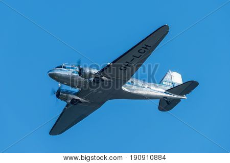 Helsinki Finland - 9 June 2017: Historical Douglas DC-3 airliner performing in the Kaivopuisto Air Show. This aircraft two engine all metallic monoplane (OH-LCH) was purchased in 1947 by then Finnish airline company Aero May 25, 2017 in Helsinki, Finland.