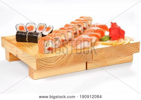 Traditional Japanese Cuisine, Sets Of Sushi And Rolls On A Wooden Stand