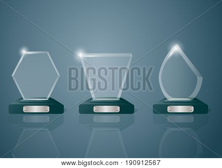 Sport competitions glass trophies prizes collection on transparent reflective surface realistic image with dark shadowy background vector illustration.