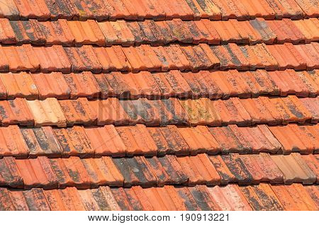 The texture of the roof. Background of old red ceramic tiles.