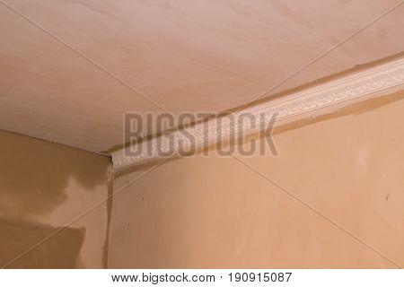 In the room repair white moldings and ceilings glued