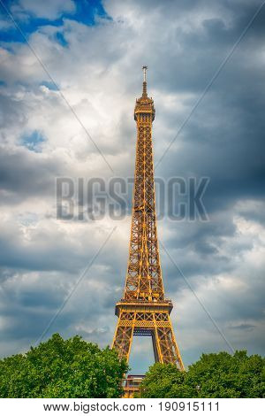 Eiffel Tower at sunset in Paris France. Romantic travel background. Eiffel tower is traditional symbol of paris and love. HDR