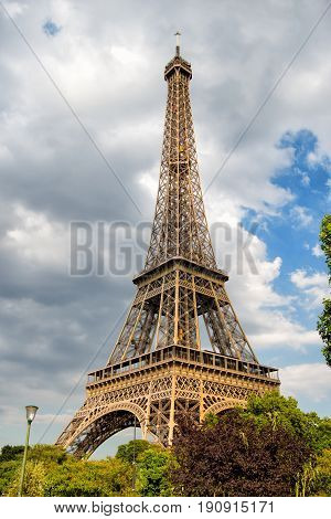 Eiffel Tower at sunset in Paris France. Romantic travel background. Eiffel tower is traditional symbol of paris and love.