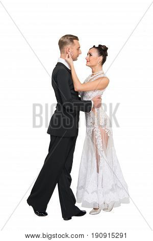 ballrom dance couple in love touching each other isolated on white bachground. sensual professional dancers dancing walz tango slowfox and quickstep