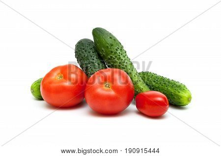 Tomatoes and cucumbers isolated on white background. Horizontal photo.