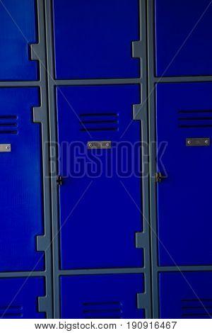 Full frame shot of blue lockers at school