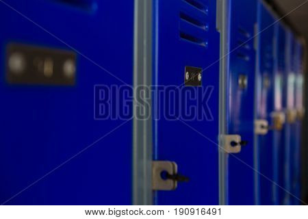 Close up of blue lockers at school