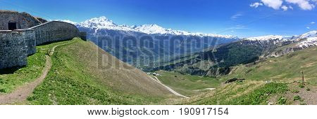 panoramic landscape of mountain in french Alps with old fortification