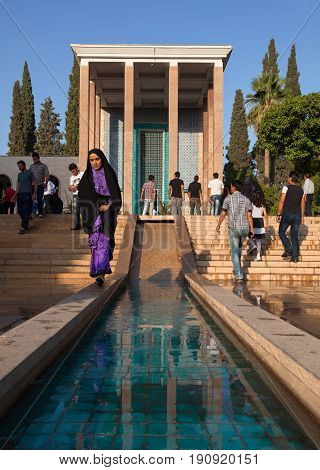 SHIRAZ IRAN - SEPTEMBER 19 2014: People visiting Saadieh the burial place of Saadi the Great Iranian Poet. This mausoleum is located in a beautiful Persian garden and is a Shiraz landmark.