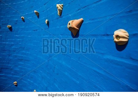 Full frame shot of blue climbing wall at school